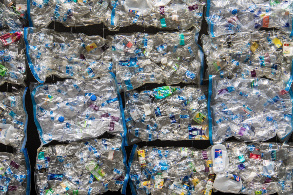 cubes of crush plastic showing the huge quantity of plastic pollution.