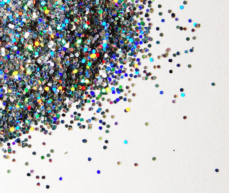 Pile of glitter spread over a white table