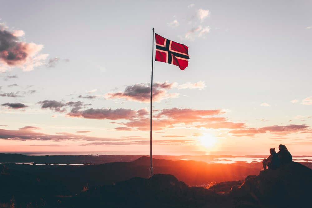 Norwegian flag waving in the sunset.