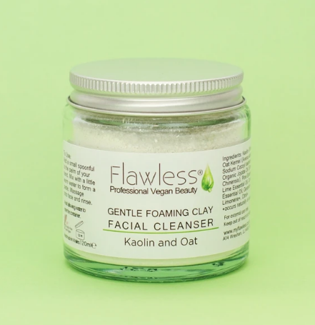 Flawless gentle foaming facial cleanser against a green background
