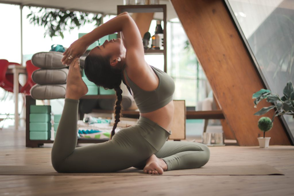 4 healthy habits to add to your daily routine | woman doing yoga